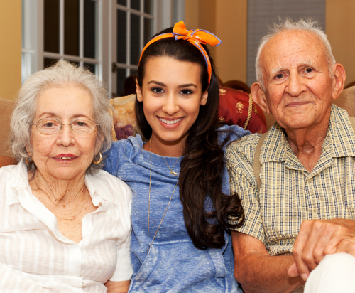 elderly couple with a caregiver